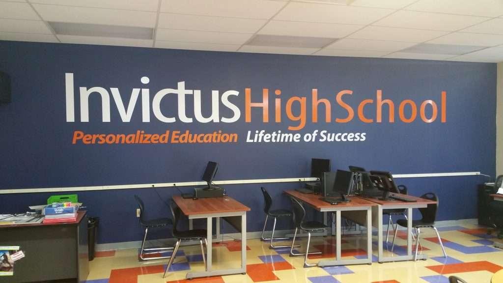 Wall decal wordmark logo at Invictus High School